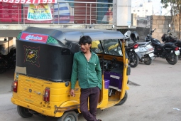 Rickshaw Driver sees something he likes